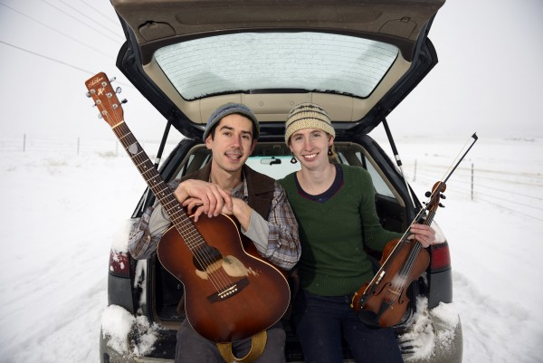Organic farmers Johanna Davis and Adam Nordell spend their off season playing folk shows and contra dances across the country as the Sassafras Stomp. This winter the couple started their tour in late November and traveled across the country to Montana where Nordell grew up. The duo will play shows across the the state during the month of January. Here they are pictured on a snowy road in Missoula, Montana, January 4, 2015.