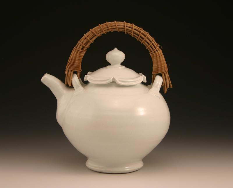 """Sarah Jaeger, """"Teapot"""", porcelain, glaze, reed handle"""