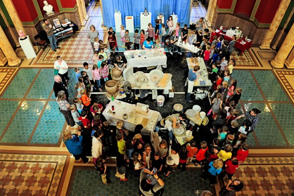 Students from Jefferson Elementary surround Montana Clay demos